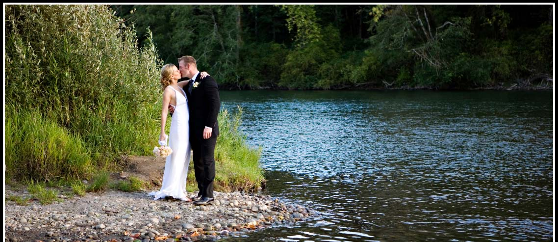 A couple in a loving embrace beside a creek at the Lewis River Golf Course